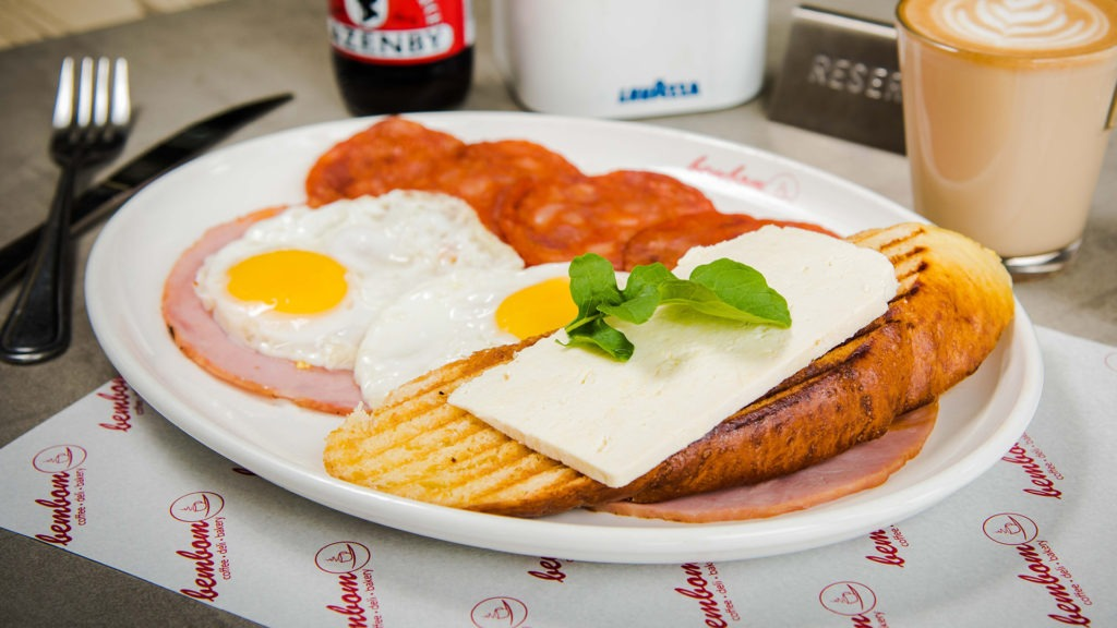 "Bem Bom breakfast – Two eggs, grilled hickory ham, ""salsichão"" & a slice of carcaça toast topped with ricotta cheese."